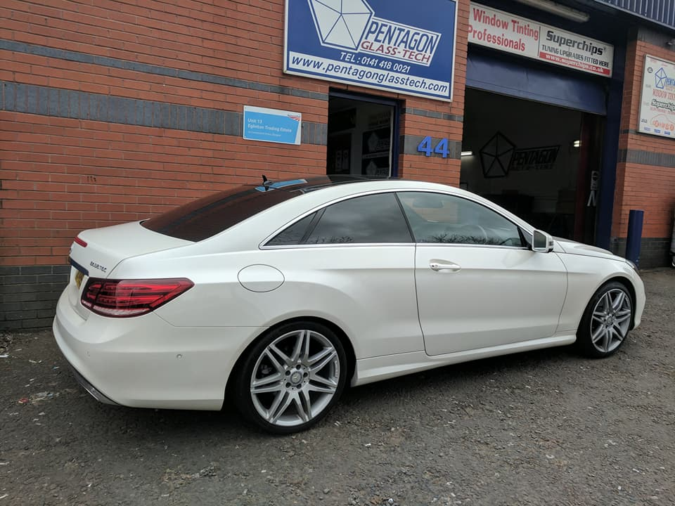 White car parked outside store
