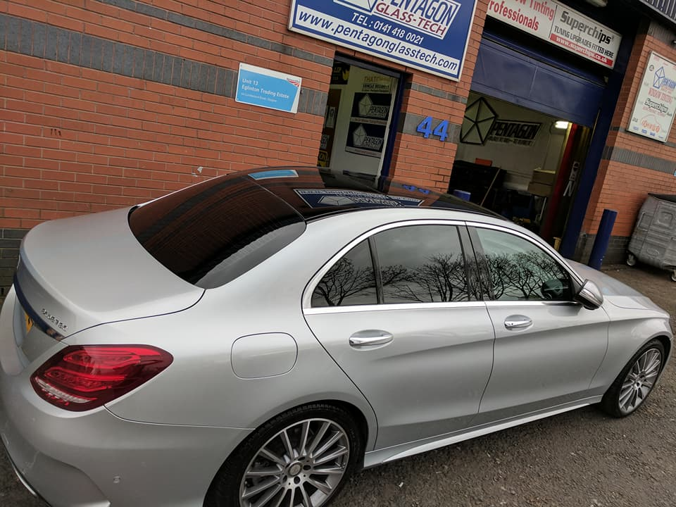 Silver car parked outside store